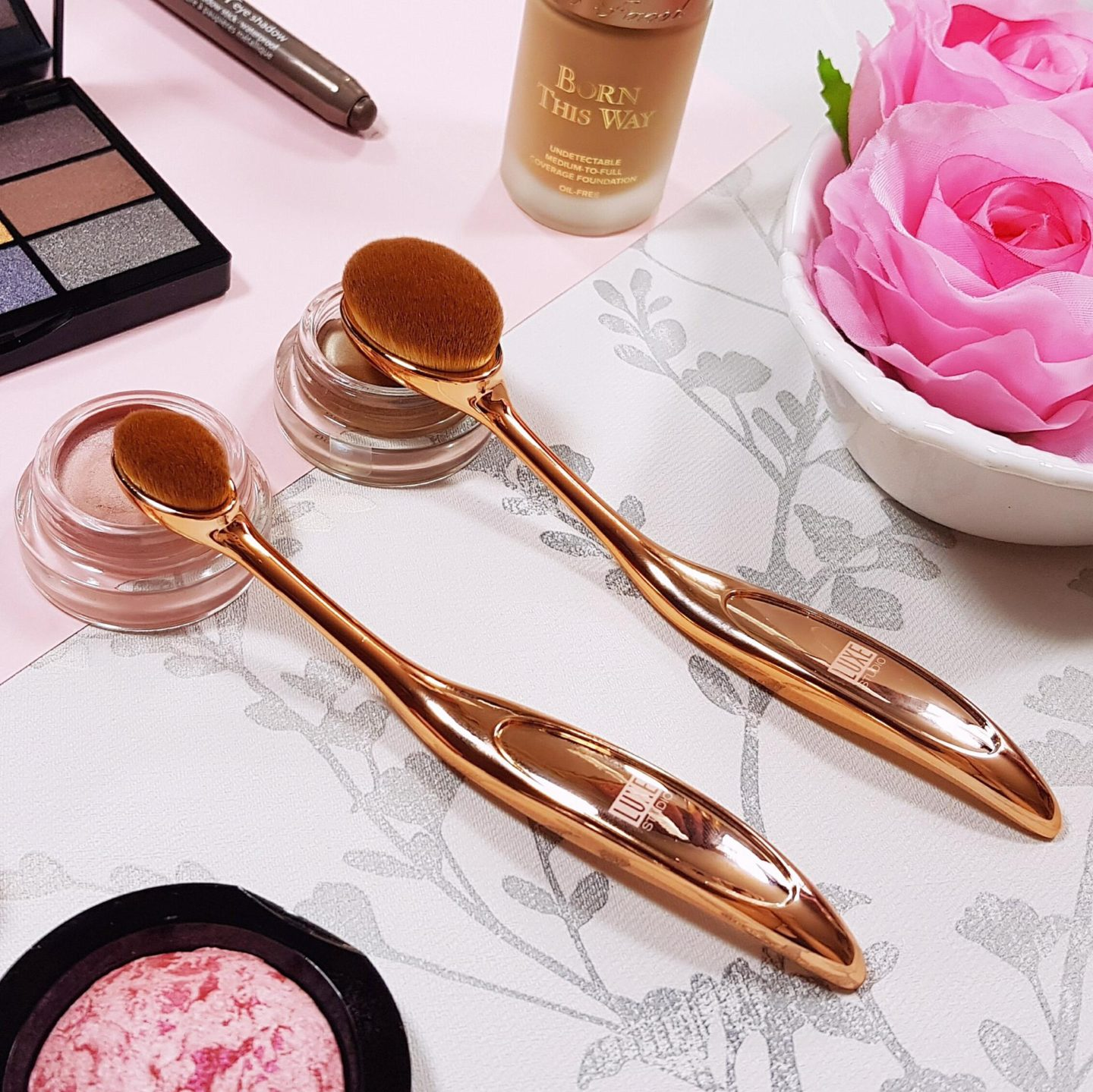 Rose Gold Makeup Brushes and a selection of makeup